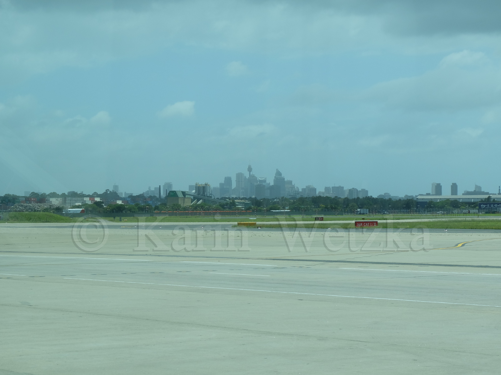 This is Sydney, seen through the windows of the airport shuttle bus.